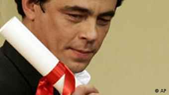 Puerto Rican actor Benicio del Toro holds the best actor award for his role in the film Che