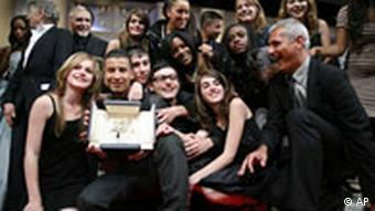 Laurent Cantet, right, and pupils of a Paris junior high school hold the Palme d'Or award for best film