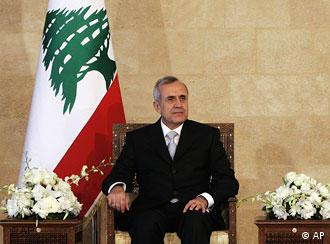 Lebanese President Michel Suleiman sits on a chair at the presidential palace
