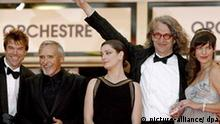 German director Wim Wenders (2nd R) , Ukraine born US actress Milla Jovovich (R) and cast members (L-R) German Singer / actor Campino, US actor Dennis Hopper and Italian actress Giovanna Mezzogiorno arrive at festival palace for the gala screening of German director Wim Wenders' film 'The Palermo Shooting' running in competition at the 61st edition of the Cannes Film Festival, 24 May 2008, in Cannes, France. EPA/GUILLAUME HORCAJUELO +++(c) dpa - Report+++