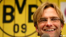 Newly appointed head coach Juergen Klopp smiles during a press onference of German first division Bundesliga soccer club Borussia Dortmund at the stadium in Dortmund, Germany, on Friday May 23,2008. (AP Photo/Alex Gottschalk)