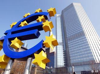 Euro sculpture and European Central Bank in Frankfurt,