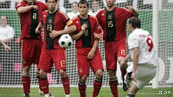 Germany's Torsten Frings, Michael Ballack, Miroslav Klose and Thomas Hitzlsperger, from left, defend a freekick