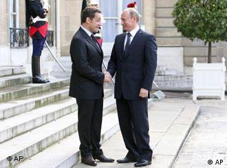 French President Nicolas Sarkozy welcomes Russian Prime Minister Vladimir Putin at the Elysee Palace