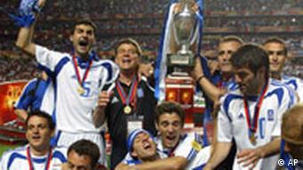 Otto Rehagel, second from left, the coach of Greece, celebrates with the team after beating Portugal 1-0 at the end of the Euro 2004 soccer championship final match at the Luz stadium in Lisbon, Portugal, Sunday, July 4, 2004.