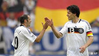 Germany's scorer Oliver Neuville, left, celebrates with scorer Michael Ballack
