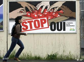 SVP posters showing brown hands grasping for Swiss passports with the word Stop