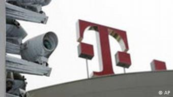 Telekom's logo is seen on top of its roof next to cameras