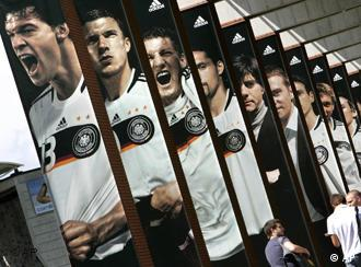 Giant poster portraying German players, from left, Michael Ballack, Lukas Podolski, Tobias Schweinsteiger Kevin Kuranyi and coach Joachim Loew are seen at the training site of the German national soccer team in Tennero near Ascona, Switzerland