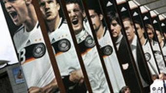 Giant poster portraying German players, from left, Michael Ballack, Lukas Podolski, Tobias Schweinsteiger Kevin Kuranyi and coach Joachim Loew are seen at the training site of the German national soccer team in Tennero near Ascona, Switzerland, Tuesday, June 3, 2008, Germany is in group B at the Euro 2008 European Soccer Championships in Austria and Switzerland.