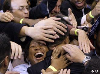 Democratic presidential hopeful, Sen. Barack Obama D-Ill., center, is covered in hands as supporters surround him after his primary election night speech in St Paul, Minn. Tuesday, June 3, 2008. (AP Photo/Chris Carlson)