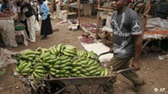 A vendor transports bananas in a wheel barrow at a market in the Kibera slum in Nairobi, Kenya