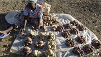 A woman selling potatoes