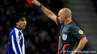 Referee Howard Webb shows FC Porto player Fucile, a red card