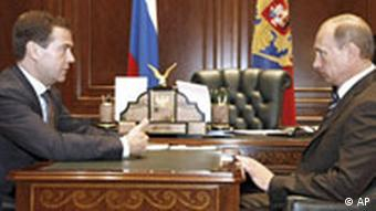 Russian President Dmitry Medvedev, left, and Prime Minister Vladimir Putin