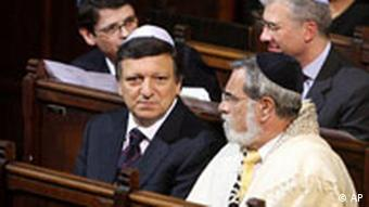 EU Commission President Jose Manuel Barroso, center, sits next to Britain's chief rabbi Sir Jonathan Sacks at the main synagogue of Brussels.