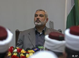 Hamas' Prime Minister Ismail Haniyeh visits a court building in Gaza City Thursday, June 5, 2008. Palestinian President Mahmoud Abbas called Wednesday for new dialogue with Hamas, in what appeared to be an about-face after insisting for a year that he would not talk with the Islamic militant movement unless it first gave up control of Gaza. (AP Photo/Khalil Hamra)