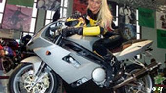 A grey motorbike presented by a blonde woman