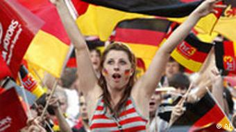 Fans of the German national soccer team celebrate during a public viewing