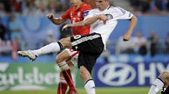 Germany's Lukas Podolski, second from left, scores during the group B match between Germany and Poland