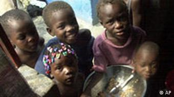 Children in a Haiti slum finish a bowl of rice and beans