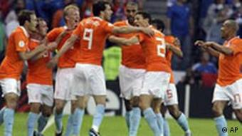 Netherlands' Ruud van Nistelrooy, fourth from left, celebrates with teammates after scoring the opening goal during the group C match between the Netherlands and Italy