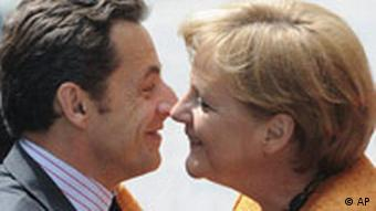 Merkel and Sarkozy exchanging kisses