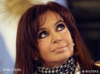 Argentina's President Cristina Fernandez de Kirchner looks up during a ceremony at the Casa Rosada Presidential Palace in Buenos Aires, June 9, 2008. Argentina's government unveiled on Monday a plan to use revenue from controversial soy export taxes to finance investment in new hospitals, rural highways and housing. The social redistribution program was announced at the presidential palace before center-left Fernandez made a speech, hours after farmers ended their third protest in three months over a tax hike on soy exports. REUTERS/Marcos Brindicci (ARGENTINA)