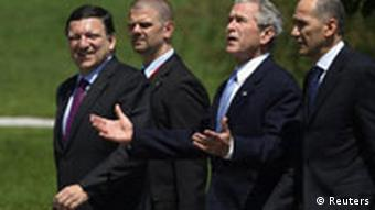 U.S. President Bush walks to a news conference with EC President Barroso, Janez Jansa, prime minister of Slovenia and their security detail at Brdo Castle