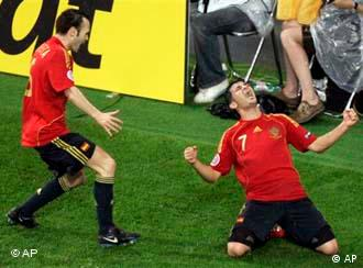 Spain's David Villa, right, celebrates with Andres Iniesta after scoring his second goal