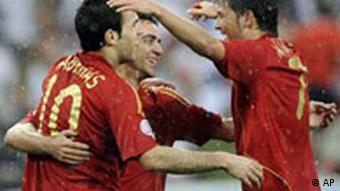 Spain's Cesc Fabregas, left, celebrates after scoring a goal with fellow team member Xavi Fernandez, right, during the group D match between Spain and Russia in Innsbruck, Austria, Tuesday, June 10, 2008, at the Euro 2008 European Soccer Championships in Austria and Switzerland.