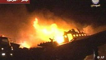 This video frame grab image taken from Sudan TV via AP Television News shows a plane that burst into flames after apparently veering off a runway at an airport in Khartoum, Sudan, Tuesday June 10, 2008. About 200 passengers are thought to have been aboard, but it is unclear how many might be casualties. (AP Photo/Sudan TV via APTN)