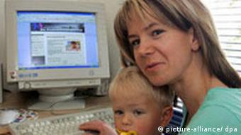 mother and baby in front of computer