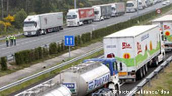 Several decens of trucks block the hard shoulders of the A6 highway near Guitiriz, Galicia, northwestern Spain, 10 June 2008. Spanish haulers are holding an indefinitive strike against fuel prices