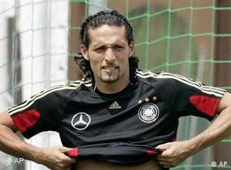 German forward Kevin Kuranyi pulls up his shirt during a training session of the national soccer team