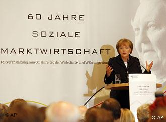 German chancellor Angela Merkel at podium giving a speech at an industry conference