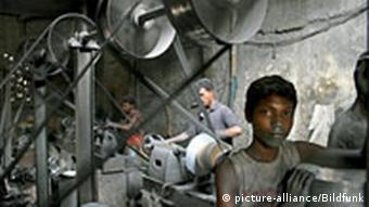 Bangladeshi boy Amin (15 years old) works in aluminum factory at Kamrangir Char, Dhaka, Bangladesh 12 June 2008. In Bangladesh, at least 7.4 million children aged 5 to 17 are involved in various types of economic activities. Of them, 1.3 million are involved in hazardous work in the country, according to the International Labour Organisation (ILO). EPA/ABIR ABDULLAH +++(c) dpa - Bildfunk+++