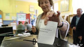 An Irish voter casts her ballot in Dublin