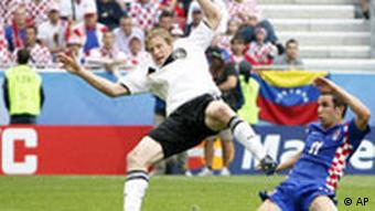 Croatia's Darijo Srna, right, scores the opening goal past Germany's Marcell Jansen during the group B match between Croatia and Germany in Klagenfurt, Austria, Thursday, June 12, 2008, at the Euro 2008 European Soccer Championships in Austria and Switzerland.