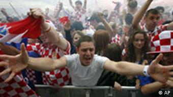 Croatian soccer fans celebrate after Croatia scored the first goal in the mach between Croatia and Germany