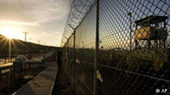 ** FILE ** In this June 6, 2008 file photo, reviewed by the U.S. Military, the sun rises over Camp Delta detention compound at Guantanamo Bay U.S. Naval Base, in Cuba. The Supreme Court ruled Thursday, June 12, 2008, that foreign terrorism suspects held at Guantanamo Bay have rights under the Constitution to challenge their detention in U.S. civilian courts. (AP Photo/Brennan Linsley, Pool, File)