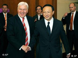 German Foreign Minister Frank-Walter Steinmeier, left, shakes hands with his Chinese counterpart Yang Jiechi before their meeting in Beijing on Friday, June 13, 2008