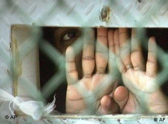 Guantanamo prisoner behind barbed wire