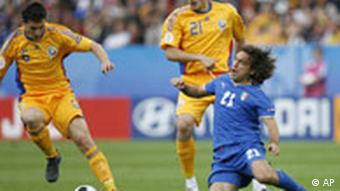 Italy's Andrea Pirlo, right, challenges for the ball