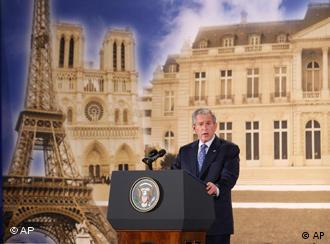 US President George W. Bush delivers a speech, famous Parisian buildings are pictured in the background