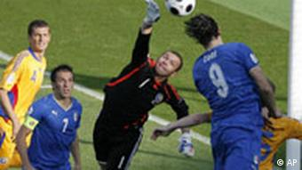 Italy's Luca Toni, right, heads the ball