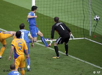 Adrian Mutu took advantage of a defensive blunder by Gianluca Zambrotta on 55 minutes to put Romania in front but within a minute Italy were level when Christian Panucci tapped in from close range after Giorgio Chiellini headed back across the goal of Bogdan Lobont. But Italy, who lost 3-0 to the Netherlands in their opening match, were staring a second defeat in a row in the face when, with nine minutes remaining, Panucci was judged to have fouled Daniel Niculae. However, Buffon managed to brilliantly parry Mutu's penalty and salvage a vital draw, which gives Roberto Donadoni's side their first point of the campaign. The result sees Romania, who played out a scoreless draw France their opening match, move on to two points. Donadoni rang the changes for this match, making five changes from the side that lost so heavily to the Dutch. Determination Both sides went into the game knowing that a defeat would probably mean the end of their Euro hopes and the teams played attacking football in the first half, creating several chances. The Romanians were weakened in the 22nd minute after Mirel Radoi had to be stretchered off with a head injury after colliding with a teammate. The defender was substituted for Nicolae Dica. Romania nearly took the lead in the 17th minute after Mutu was sent through, but the Fiorentina striker failed to beat the advancing Buffon. Three minutes later the Romanians had another opportunity as a Christian Chivu free kick took a deflection off Panucci but crashed against the post. Italy comes back Italy enjoyed a very strong spell shortly before the break as Lobont pulled off some breathtaking stops from Luca Toni and Giorgio Chiellini. In first-half injury time Toni finally had the ball in the back of the net after a header following a Zambrotta free kick, but referee Tom Henning Oevreboe ruled the attempt offside. Early in the second half, Romania finally broke the deadlock after a disastrous attempt at a header to his own goalkeeper by Zambrotta. The ball fell short and Mutu was on hand to smash the ball past Buffon. The lead lasted just a minute though as Chiellini headed the ball into the area after a corner and after several Romanian defenders failed to clear, it fell to Panucci, who was standing just a meter or so from the line and had a simple task of pushing the ball into the net. Italy pushed in search of a winner and in the 75th minute Daniele de Rossi forced a world-class save from Lobont after being set up by Toni. Romania's Adrian Mutu, right, scores the opening goal past Italy's Gianluigi Buffon