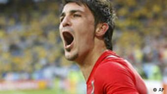 Spain's David Villa celebrates scoring his side's 2nd goal during the group D match between Sweden and Spain in Innsbruck