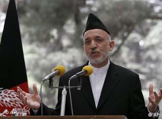 Afghan President Karzai warns Pakistan at a press conference on 15 June