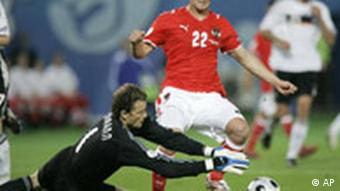 Germany's Jens Lehmann, left, seizes the ball ahead of Austria's Erwin Hoffer during the group B match between Austria and Germany in Vienna